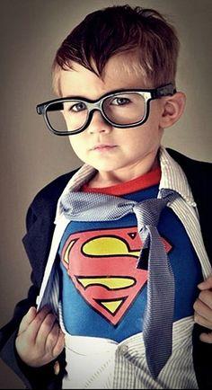 A mini Clark Kent.